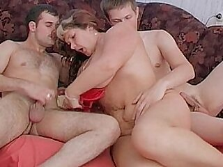 Fat mature woken up and fucked by two young guys